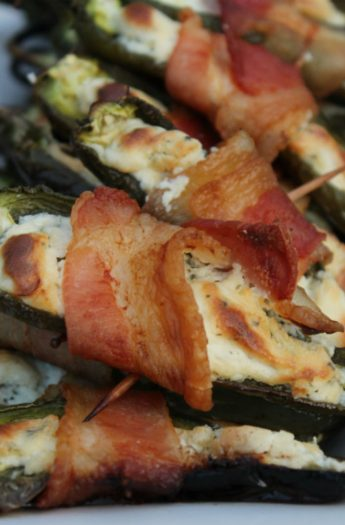 A Pile of Stuffed Jalapeños on a White, Rectangular Plate