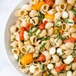 roasted tomato caprese pasta salad in a bowl