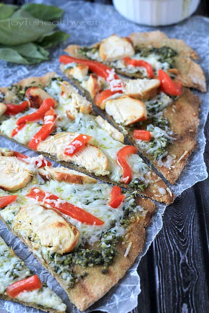 Spice up your pizza night with a Grilled Chicken Pesto Pizza, its the best way to eat pizza! | www.joyfulhealthyeats.com