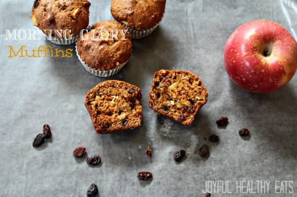 Morning Glory Muffins on a table with apples and raisins