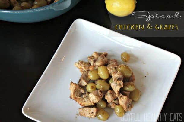 A serving of Spiced Chicken & Grapes on a plate.