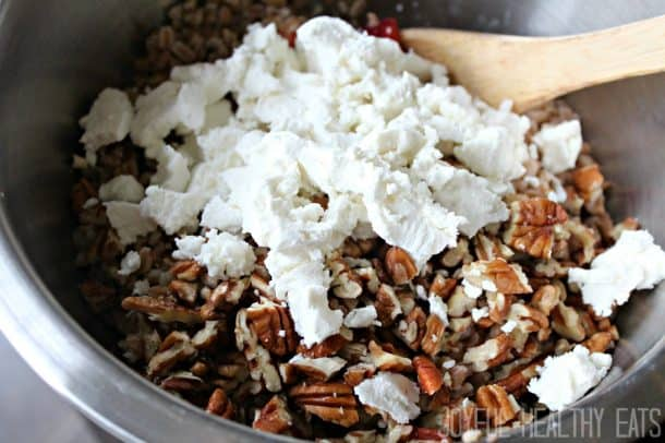 Chopped pecans and crumbled goat cheese in a mixing bowl