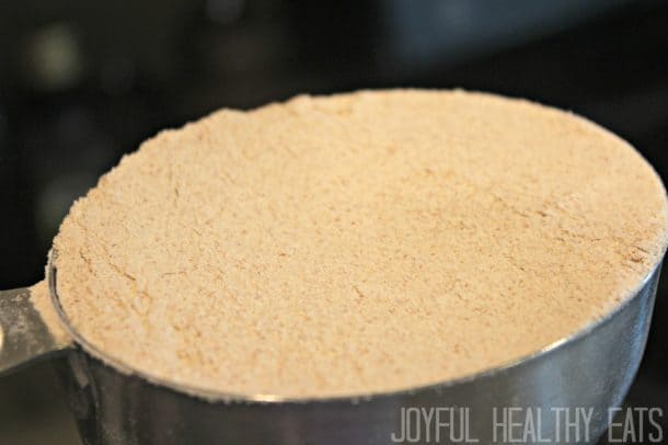 A measuring cup of whole wheat flour