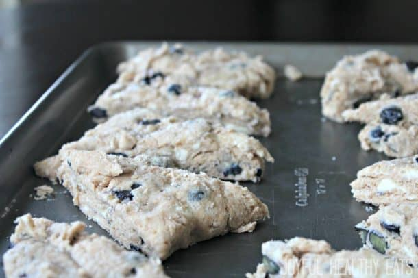 Unbaked Blueberry Lemon Scones on a baking sheet