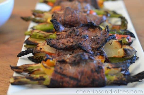 Grilled Sweet Balsamic Steak Bundles Lined Up on a Long Serving Dish