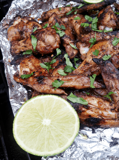 Jerk Chicken Wings in an Aluminum Foil Packet with Half a Lime
