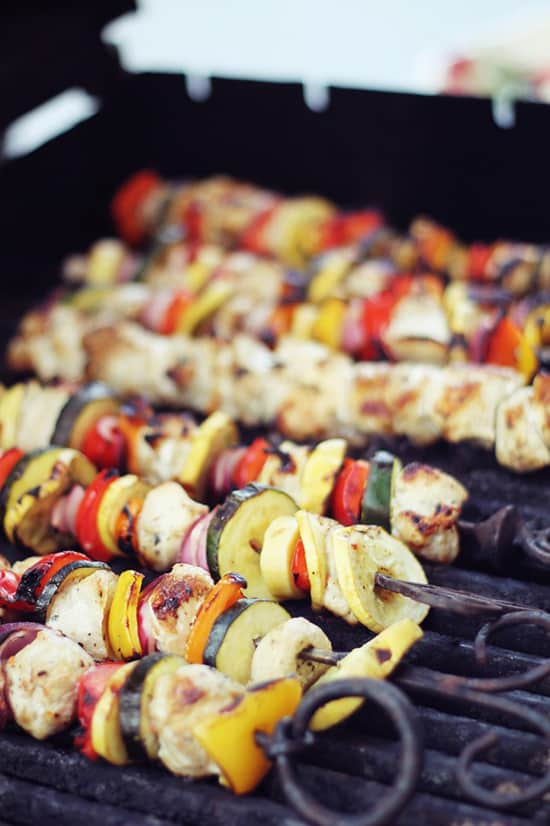 Seven Chicken Kabobs on Top of a Grill