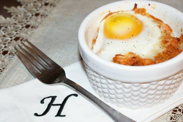 Sweet potato egg bake in a white ramekin
