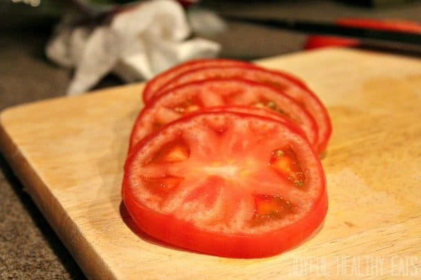 Sliced tomato on a cutting board