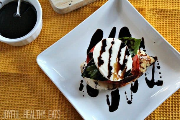 Caprese chicken stack on a plate with balsamic drizzle
