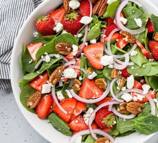 strawberry spinach salad in a bowl