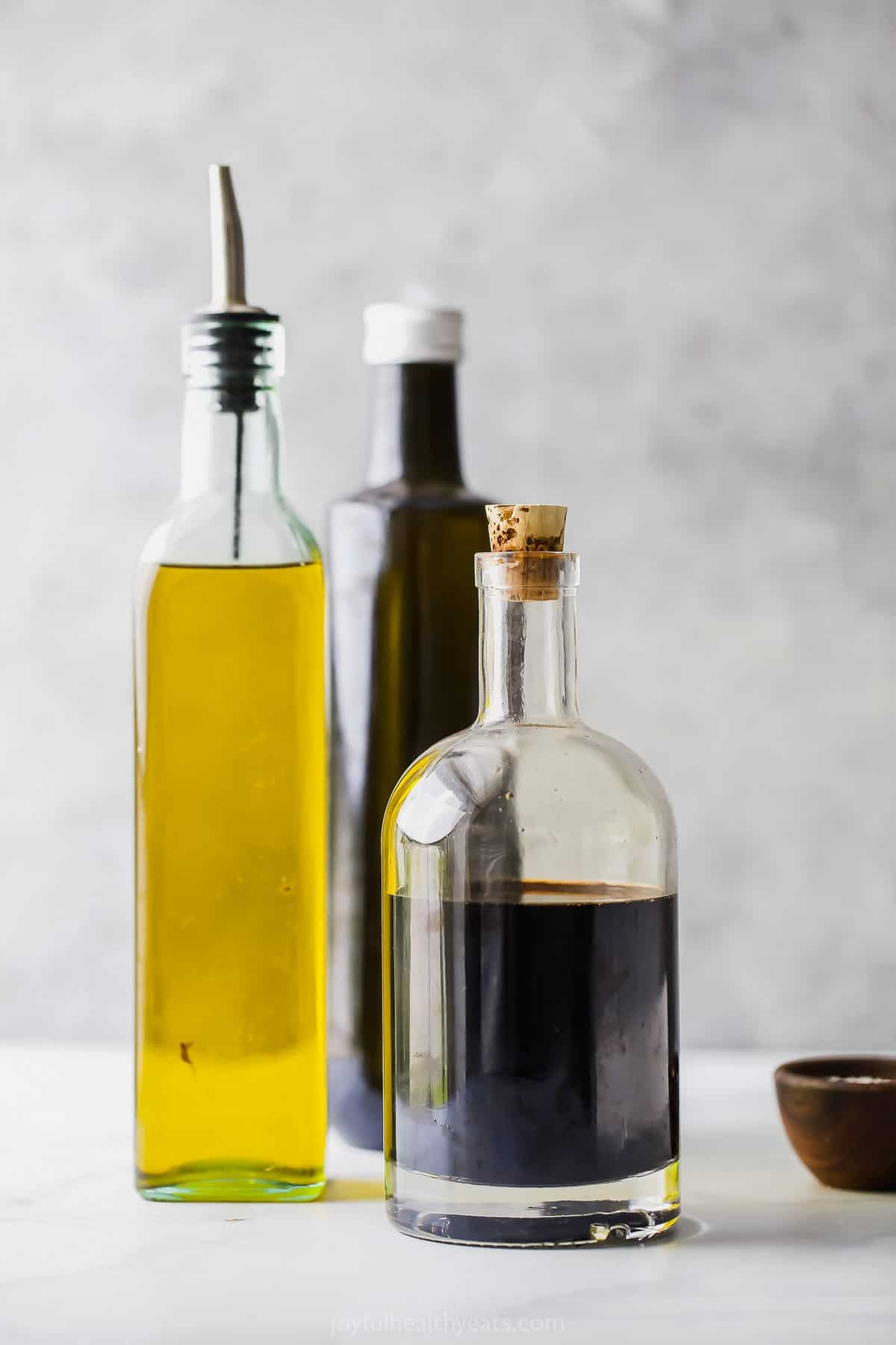 picture of bottles filled with balsamic vinegar and olive oil