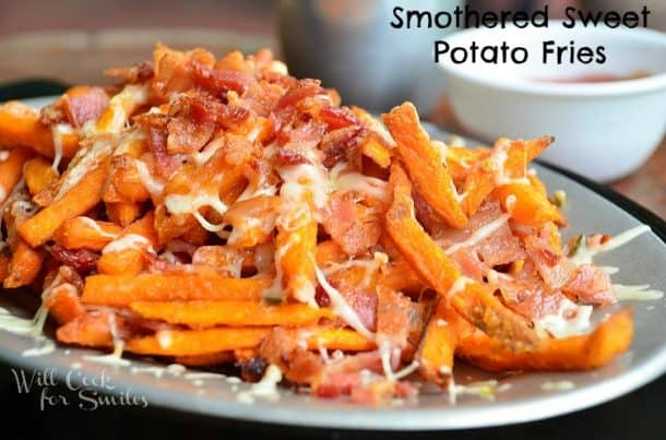 Smothered sweet potato fries on a plate