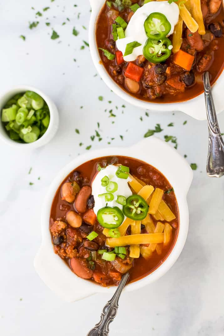 two bowls filled with crock pot chili