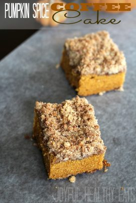 Two squares of pumpkin spice coffee cake on a granite countertop