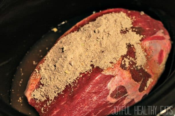 Raw pot roast with seasoning