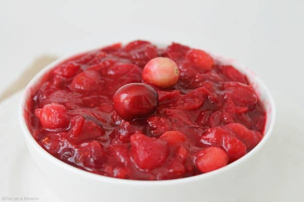 A white bowl of maple cinnamon cranberry sauce