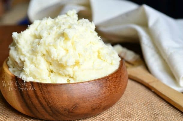 Wooden serving bowl of mashed potatoes