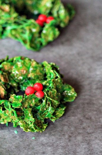 Four Christmas Wreath Cookies on a Piece of Parchment Paper