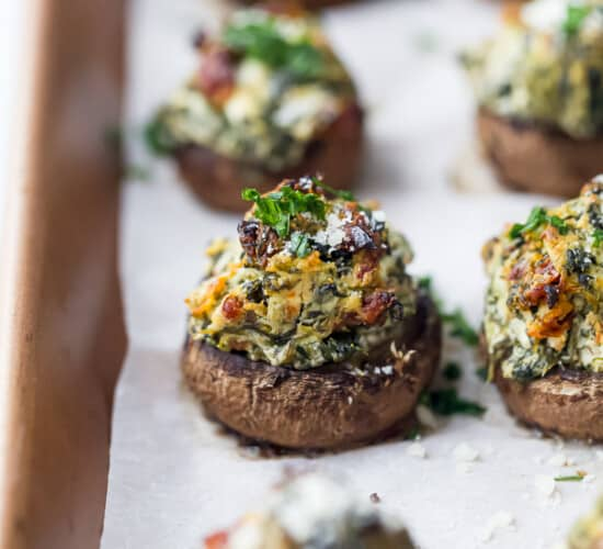 spinach stuffed mushrooms on a baking sheet