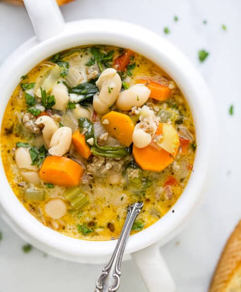 close up of a bowl filled with creamy tuscan white bean soup