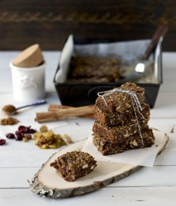 Paleo Gingerbread Granola bars in a stack on a wooden board