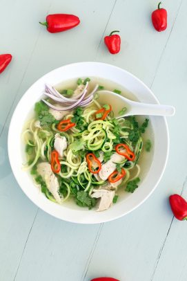 Top view of Chicken Pho Zucchini Noodle soup in a bowl