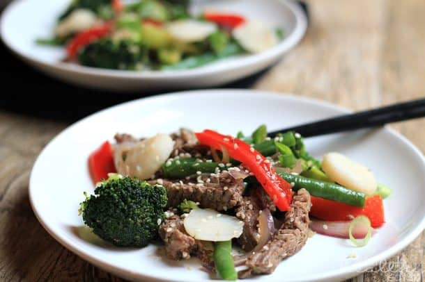 Fresh cooked Paleo Steak & Veggie Stirfry on a white plate