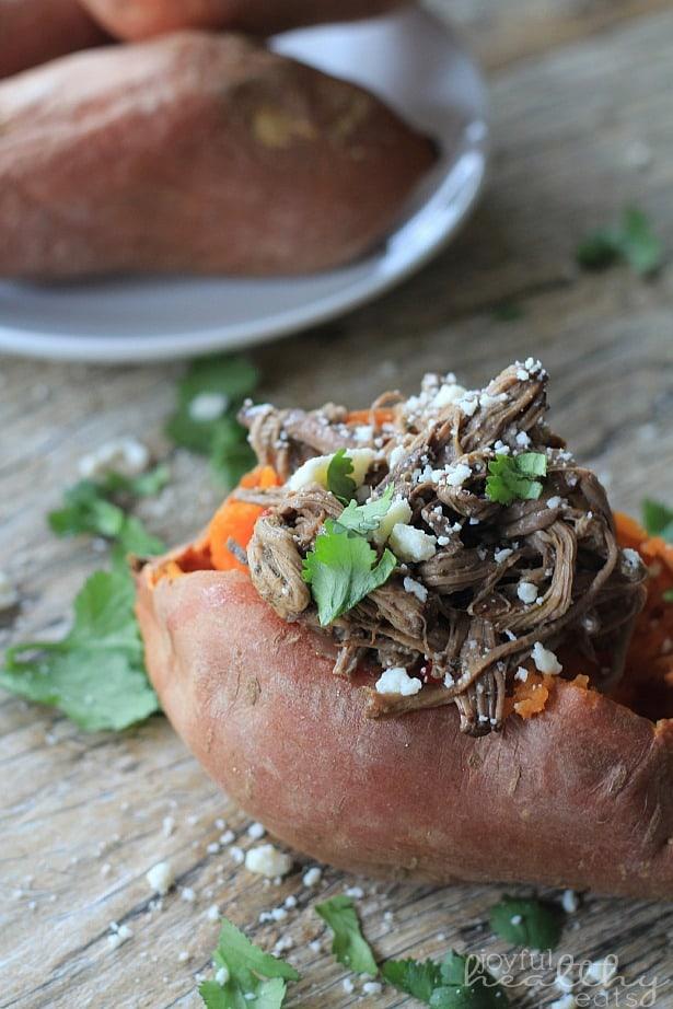 Close-up of a Chipotle Beef Barbacoa Stuffed Sweet Potato