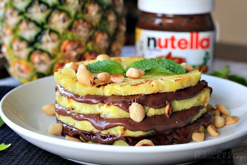 Layered Grilled Pineapple with Nutella & Macadamia Nuts on a plate