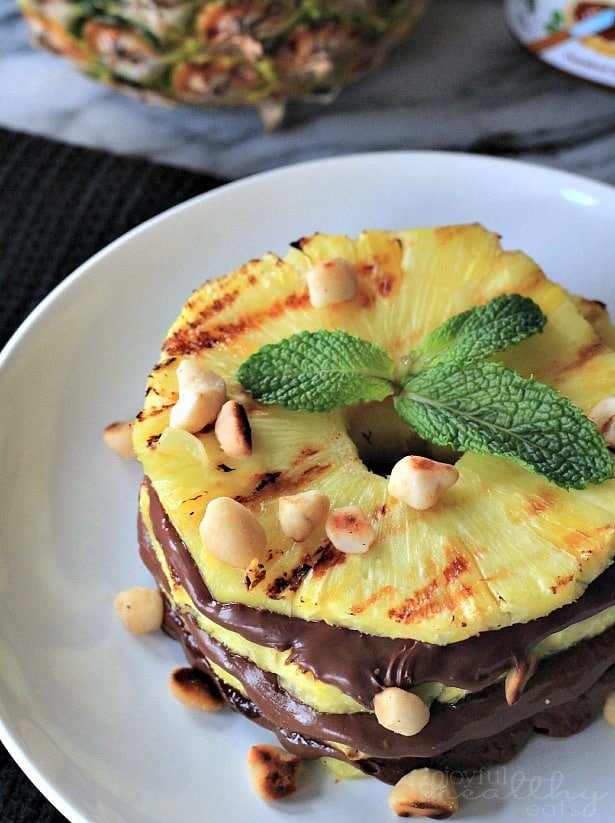 Top view of Grilled Pineapple rings with Nutella & Macadamia Nuts on a plate