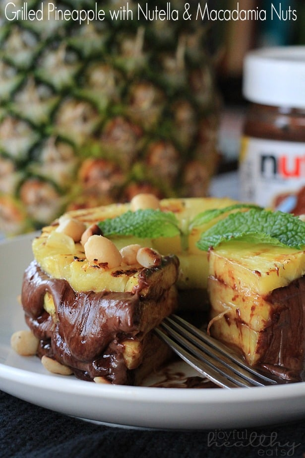 Grilled Pineapple layered with Nutella & Macadamia Nuts on a plate with a wedge missing