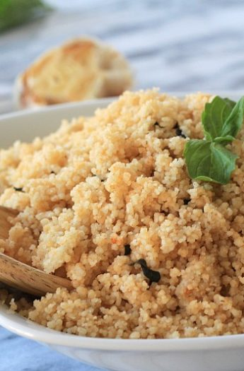 Roasted Garlic & Herb Couscous with a Wooden Spoon