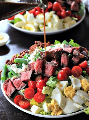 Ribeye Steak Salad with Balsamic Vinaigrette on a white plate