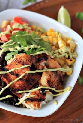 Grilled Tilapia bowl with veggies and avocado crema dressing