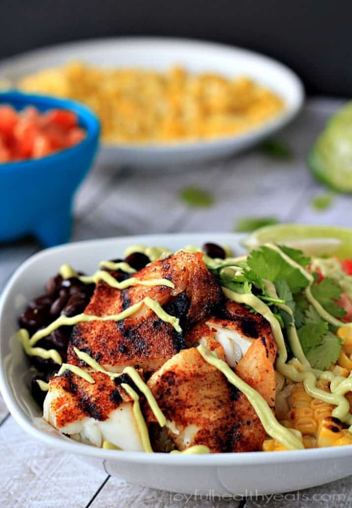 A Grilled Tilapia Bowl with Chipotle Avocado Crema Drizzled on Top