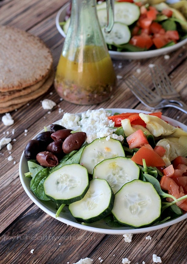 A healthy Mediterranean style Salad filled with kalamata olives, artichoke hearts, cucumber and feta then topped with a homemade Greek Vinaigrette.