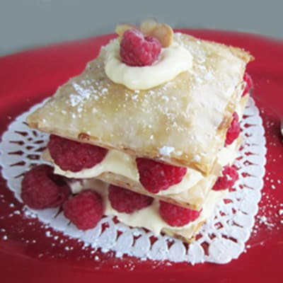 Honey Almond Fillo tart with layers of puffy fillo, custard and fresh raspberries
