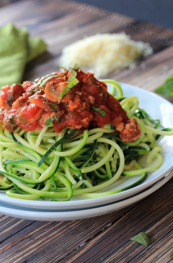 A plate full of Gluten Free & Paleo Zucchini Noodles with Meat Mushroom Tomato Sauce | www.joyfulhealthyeats.com