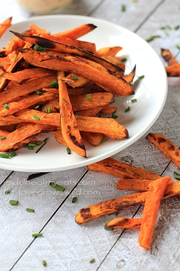 Crispy Baked Sweet Potatoes Fries served with a delicious Chipotle Lime Aioli is a great healthy side dish idea! | LoveGrowsWild.com
