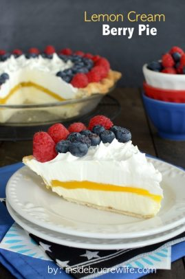 A slice of lemon cream berry pie on a plate