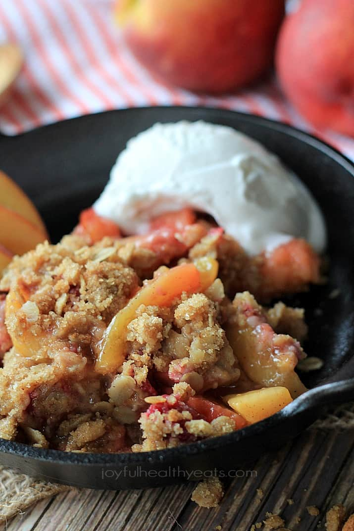 A sweet homemade Raspberry Peach Cobbler for two made with fresh raspberries, peaches, and hints of cinnamon topped with an Crunchy Oatmeal Pecan Crumble. | joyfulhealthyeats.com #recipes