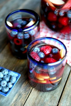 Red White and Blue Sangria and fruit in a rocks glass