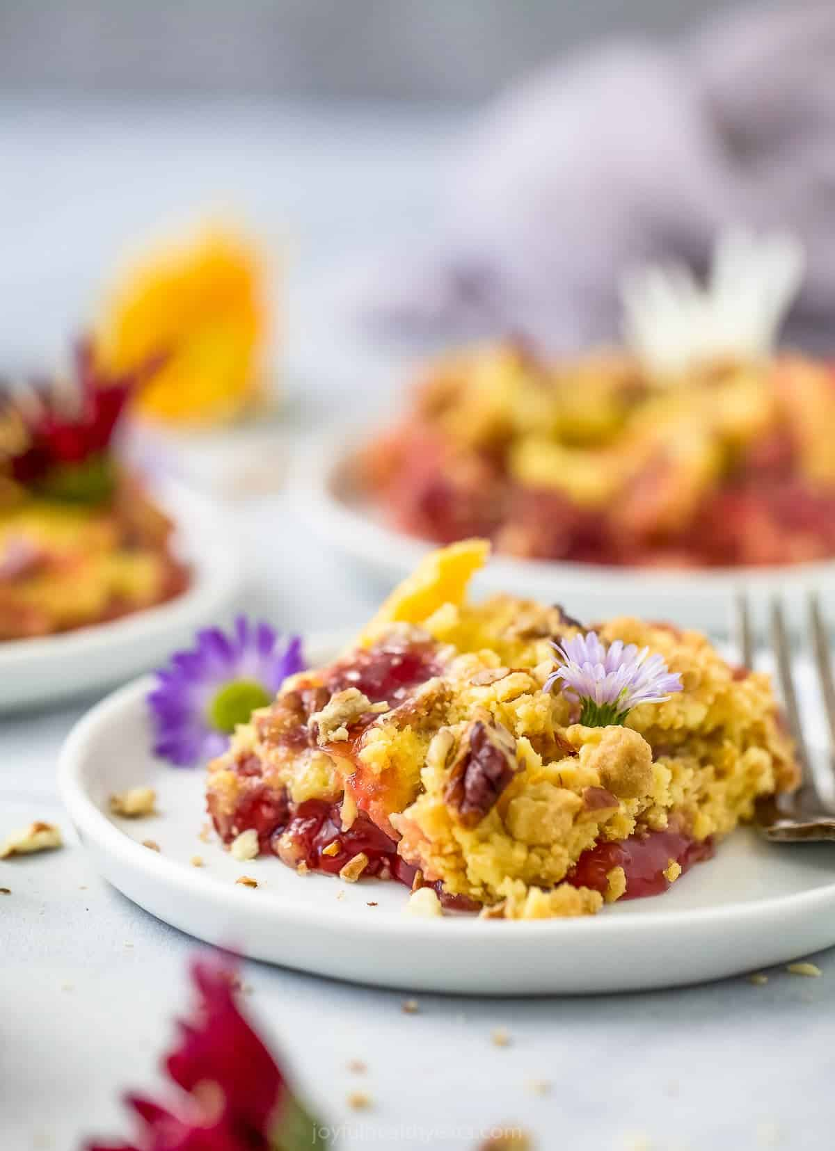 close up of plate filled with pineapple cherry dump cake