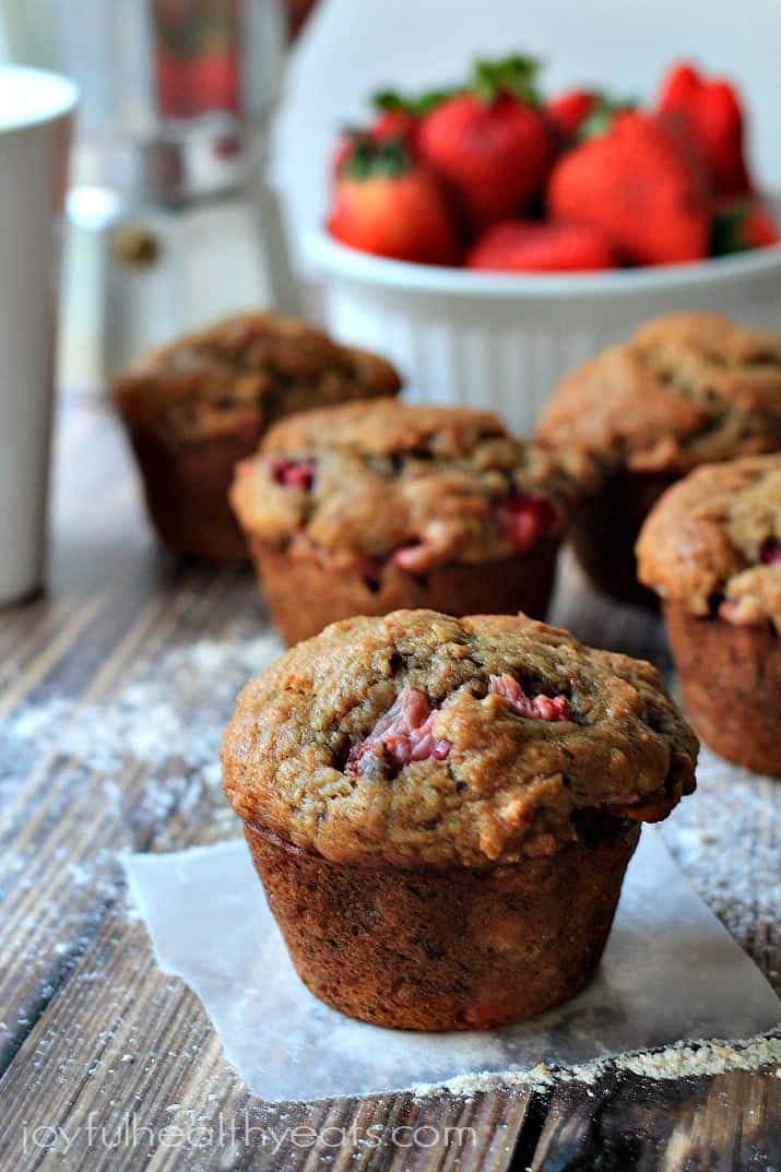 Light, moist Strawberry Banana Muffins made with whole wheat flour & packed with loads of fresh strawberries and bananas, perfect for a grab-n-go breakfast!