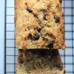 A Loaf of Coconut Pecan Chocolate Chip Banana Bread on a Cooling Rack