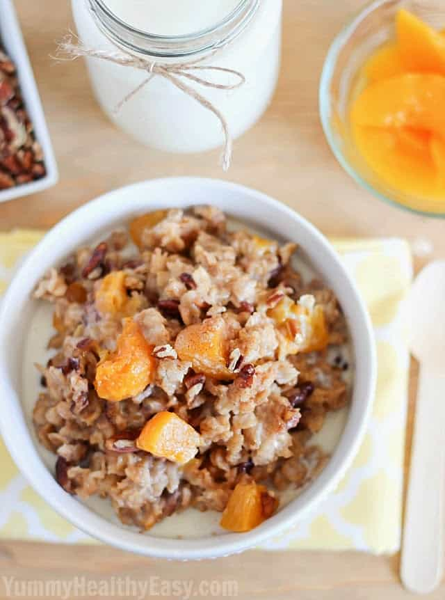 A Bowl of Peach Oatmeal with a Glass of Milk