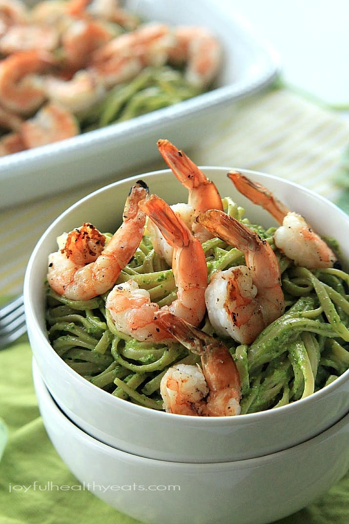 Goat Cheese Spinach Pesto Pasta with Grilled Shrimp in a bowl