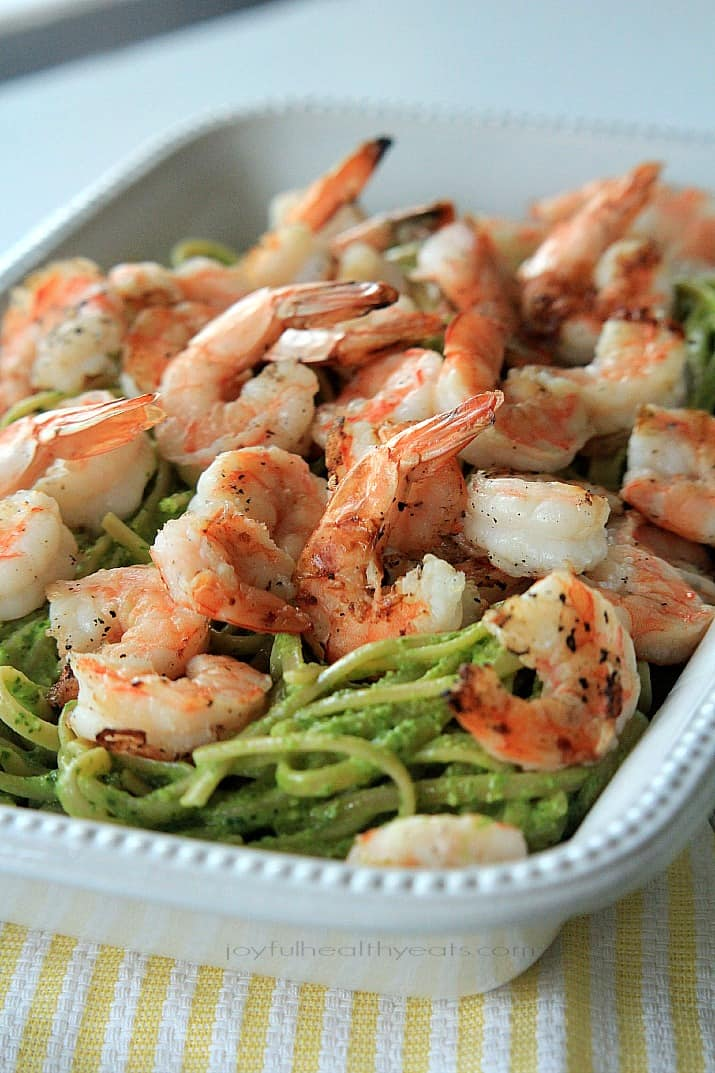 Goat Cheese Spinach Pesto Pasta with Grilled Shrimp in a serving dish