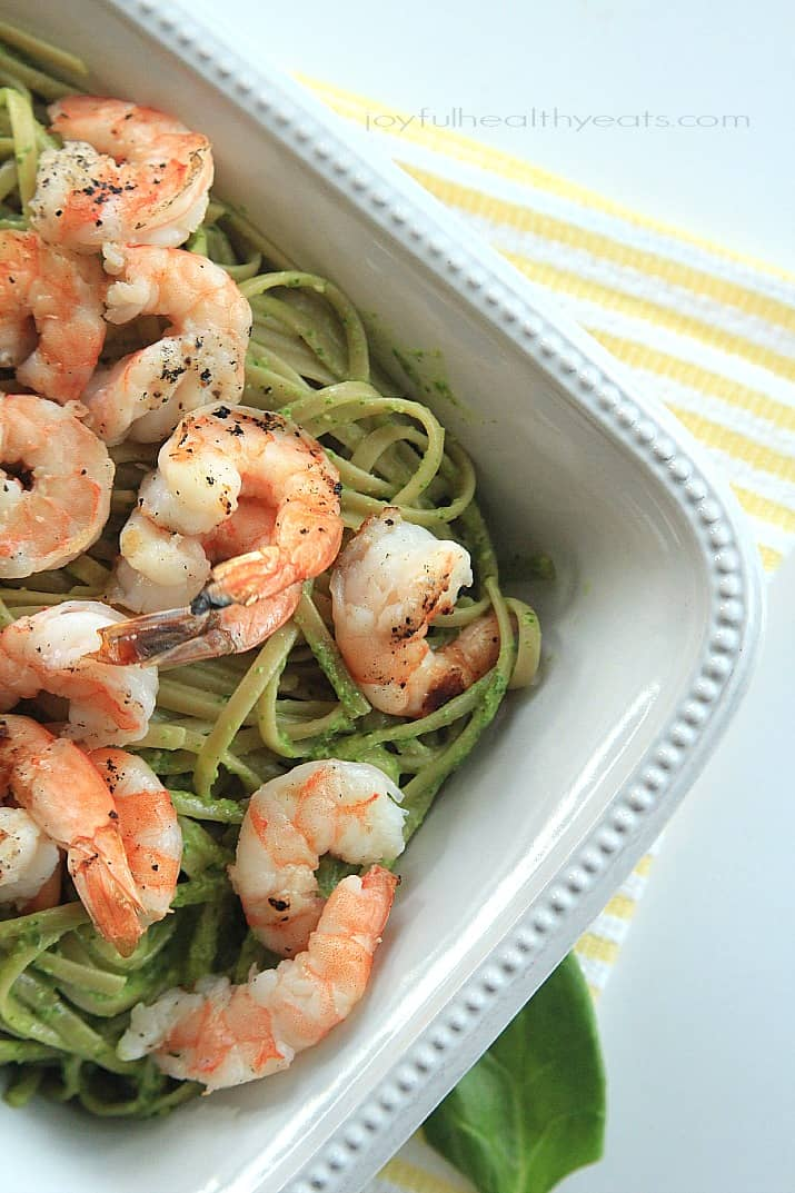 Top view of Goat Cheese Spinach Pesto Pasta with Grilled Shrimp in a serving dish